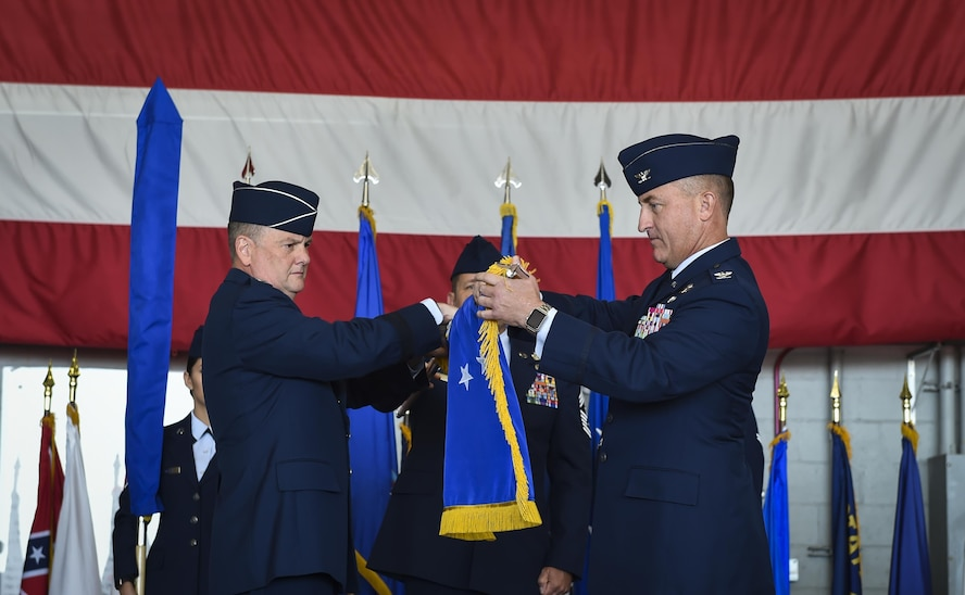 Lt. Gen. Brad Webb, left, the commander of Air Force Special Operations Command, and Col. Nathan Green, right, the commander of Air Force Special Operations Air Warfare Center,  furl the AFSOAWC flag during a ceremony at Hurlburt Field, May 10, 2017. An organizational banner is ceremoniously furled to designate a unit's inactivation. (U.S. Air Force photo by Airman 1st Class Joseph Pick)