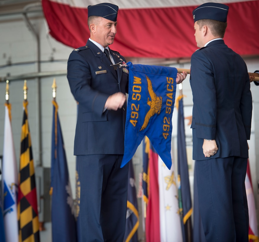 Col. Nathan Green, commander of the 492nd Special Operations Wing, activates the 492nd Special Operations Advanced Capability Squadron during an activation ceremony at Hurlburt Field, Fla., May 10, 2017. Green appointed Lt. Col. Matthew Laurentz to command the 492nd SOACS. (U.S. Air Force photo by Senior Airman Krystal M. Garrett)