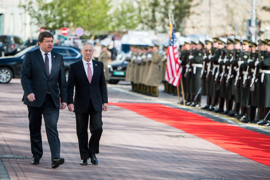 Defense Secretary Jim Mattis walks with Lithuanian Defense Minister Raimundas Karoblis