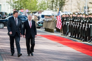 Defense Secretary Jim Mattis walks with Lithuanian Defense Minister Raimundas Karobli