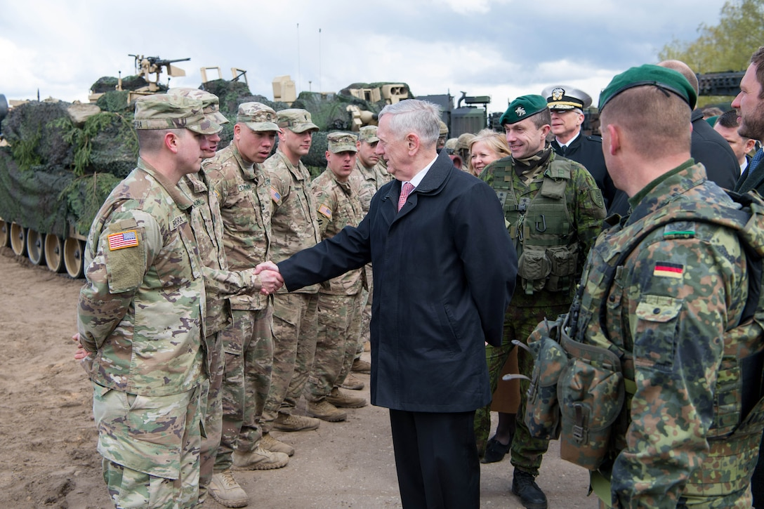 Defense Secretary Jim Mattis greets a U.S. service member