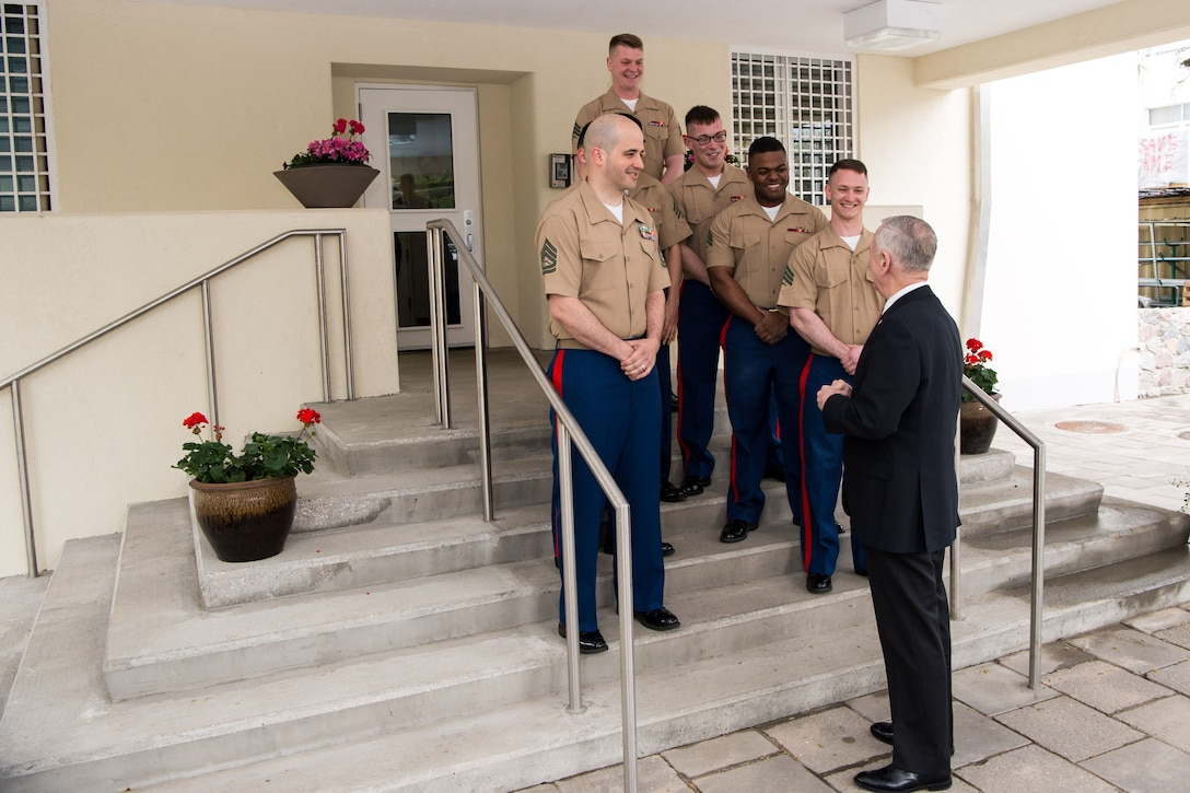 Defense Secretary Jim Mattis speaks with Marines
