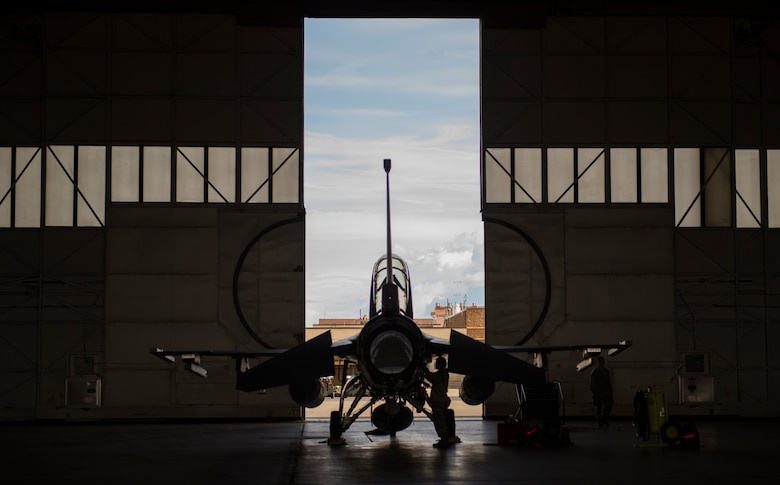 U.S. Air Force Airman 1st Class Eric Baltazar a 13th Fighter Squadron avionics technicians, performs preflight inspections during Northern Edge 2017 at Eielson Air Force Base, Alaska, May 9, 2017. NE17 is a training exercise that provides effective, flexible and capabilities-centered joint forces ready for deployment worldwide and enables real-world proficiency in detection, identification and tracking. (U.S. Air Force photo by Tech Sgt. Araceli Alarcon)