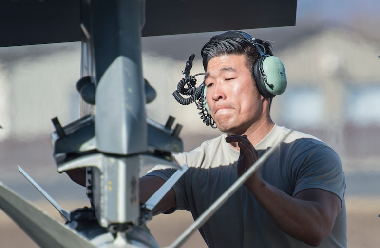 U.S. Air Force Staff Sgt. David Roh a 13th Fighter Squadron weapons technician, inspects weapons system prior to take off during Northern Edge 2017 at Eielson Air Force Base, Alaska, May 6, 2017. NE17 provides Airmen from Misawa the ability to sharpen their skills, practice operations, techniques, and procedures, continuing their commitment to the Pacific region. (U.S. Air Force photo by Tech Sgt. Araceli Alarcon)