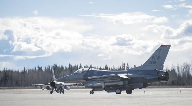 U.S. Air Force F-16 Flying Falcons with the 13th Fighter Squadron from Misawa Air Base, Japan taxi to the runway during Northern Edge 2017 at Eielson Air Force Base, Alaska, May 6, 2017. NE17 provides the opportunity to hone current and test future applications of combat operations and weapons capabilities. (U.S. Air Force photo by Tech Sgt. Araceli Alarcon)