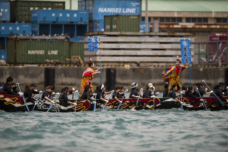 Okinawan dragon boat teams compete at the Naha Dragon Boat Race May 5, 2017, at Naha Port, Japan. Local community members, businesses and military members form teams each year to compete and build camaraderie during the largest dragon boat race on the island. (U.S. Air Force photo by Senior Airman Omari Bernard)