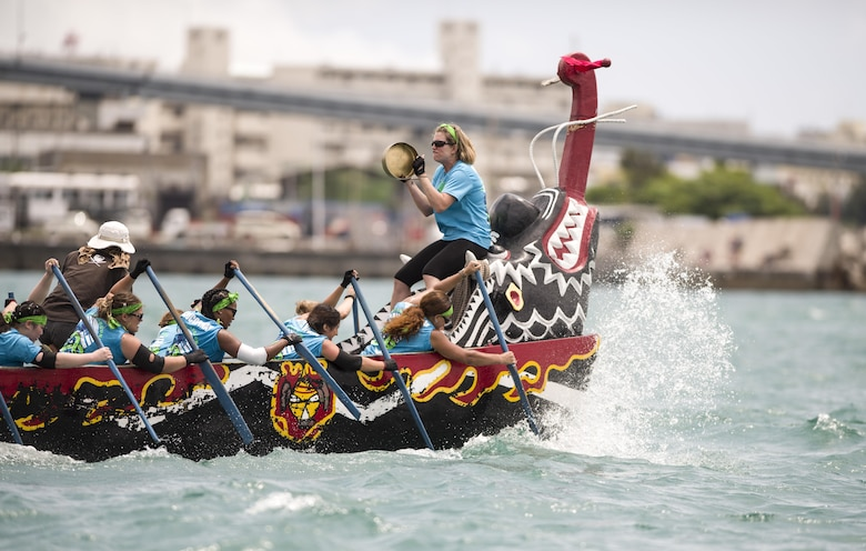 The Kadena Shoguns Women's Dragon Boat Team races to victory May 5, 2017, at Naha Port, Japan. The women's team had the 14th fastest time of the day out of 51 competing teams. (U.S. Air Force photo by Senior Airman Omari Bernard)