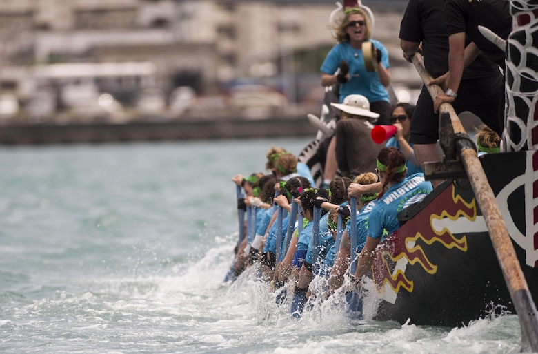 The Kadena Shoguns Women's Dragon Boat Team digs deep to finish their heat at the 43rd Annual Naha Dragon Boat Race May 5, 2017, at Naha Port, Japan. The team won their heat against the Army's and Navy's women's dragon boat teams. (U.S. Air Force photo by Senior Airman Omari Bernard)
