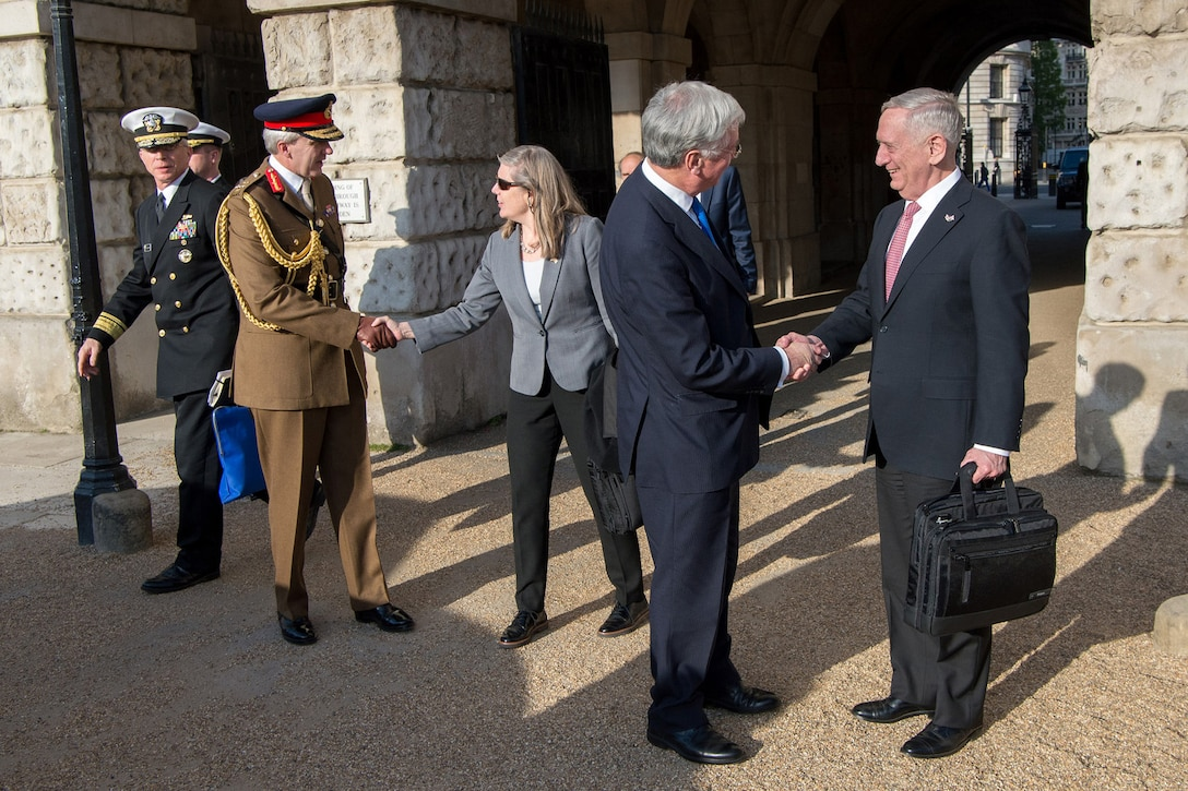 Defense Secretary Jim Mattis shakes hands with British Defense Secretary Michael Fallon
