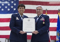 Maj. Gen. Patricia Rose, U.S. Air Force Headquarters mobilization assistant to the deputy chief of staff for logistics, engineering and force protection, presents a certificate of retirement to Col. Anna Schulte, 434th Maintenance Group commander, during her retirement ceremony at Grissom Air Reserve Base, Ind., April 1, 2017. Schulte served more than 34 years in the Air Force. (U.S. Air Force photo/Staff Sgt. Katrina Heikkinen)