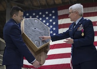 Capt. Brad Palm, 434th Maintenance Squadron accessories flight commander, presents Col. Anna Schulte, 434th Maintenance Group commander, with a shadow box he built during her retirement ceremony at Grissom Air Reserve Base, Ind., April 1, 2017. Schulte, who had been the commander of the 434th Maintenance Group for over three years, was responsible for the largest KC-135R Stratotanker unit in the Air Force Reserve Command. (U.S. Air Force photo/Staff Sgt. Katrina Heikkinen)
