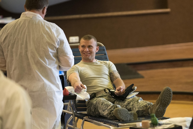 U.S. Air Force Senior Airman Allen Turner, 52nd Civil Engineer Squadron heavy equipment operator, donates blood during an Armed Services Blood Program blood drive in the Brick House at Spangdahlem Air Base, Germany, May 10, 2017. The ASBP supplies blood and blood products for 1.3 million service members and their families across the nation and around the globe every year.