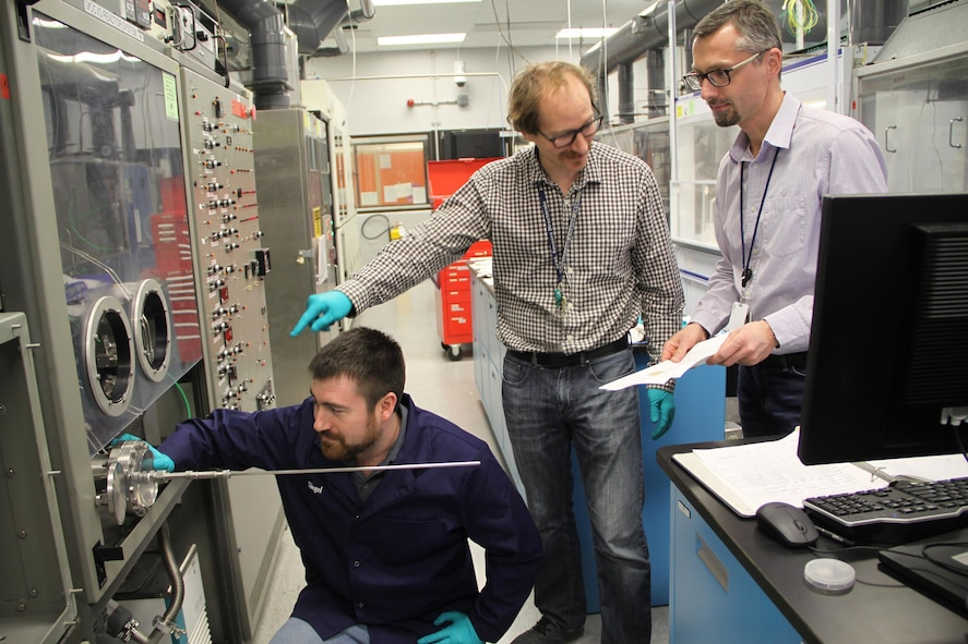 Left to right: Dr. Gene Siegel, Dr. Michael Snure, and Dr. Stefan Badescu conduct their research of hexagonal boron nitride (hBN), a ceramic material that may vastly improve the electronics used by the Air Force. (U.S. Air Force photo/Ted Pitts)