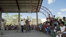 U.S. service members and local community members play basketball at Margen Elementary School in Ormoc, Leyte, May 2, 2017, as part of building camaraderie during Balikatan 2017. Balikatan is an annual U.S.-Philippine bilateral military exercise focused on a variety of missions, including humanitarian assistance and disaster relief, counterterrorism, and other combined military operations.