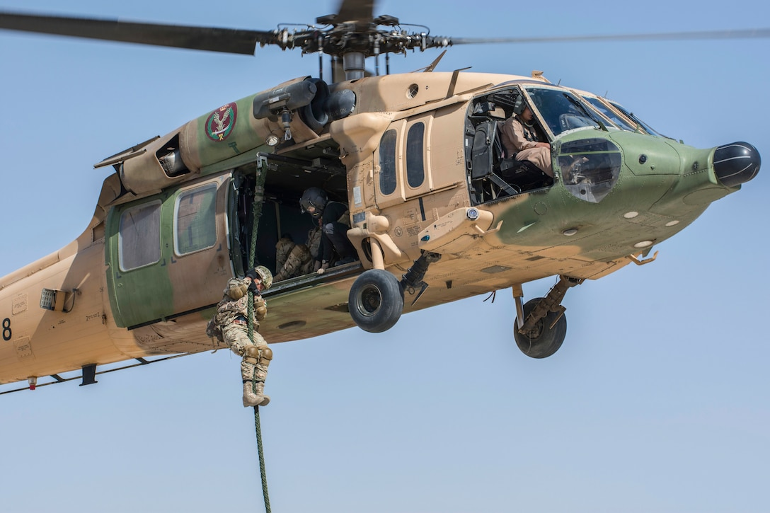AMMAN, Jordan (May 7, 2017) A member of the Jordanian Special Operations exits a helicopter during a fast roping exercise in Amman, Jordan during Eager Lion 2017. Eager Lion is an annual U.S. Central Command exercise in Jordan designed to strengthen military-to-military relationships between the U.S., Jordan and other international partners. This year's iteration is comprised of about 7,200 military personnel from more than 20 nations that will respond to scenarios involving border security, command and control, cyber defense and battlespace management. (U.S. Navy photo by Mass Communication Specialist 2nd Class Christopher Lange/Released)