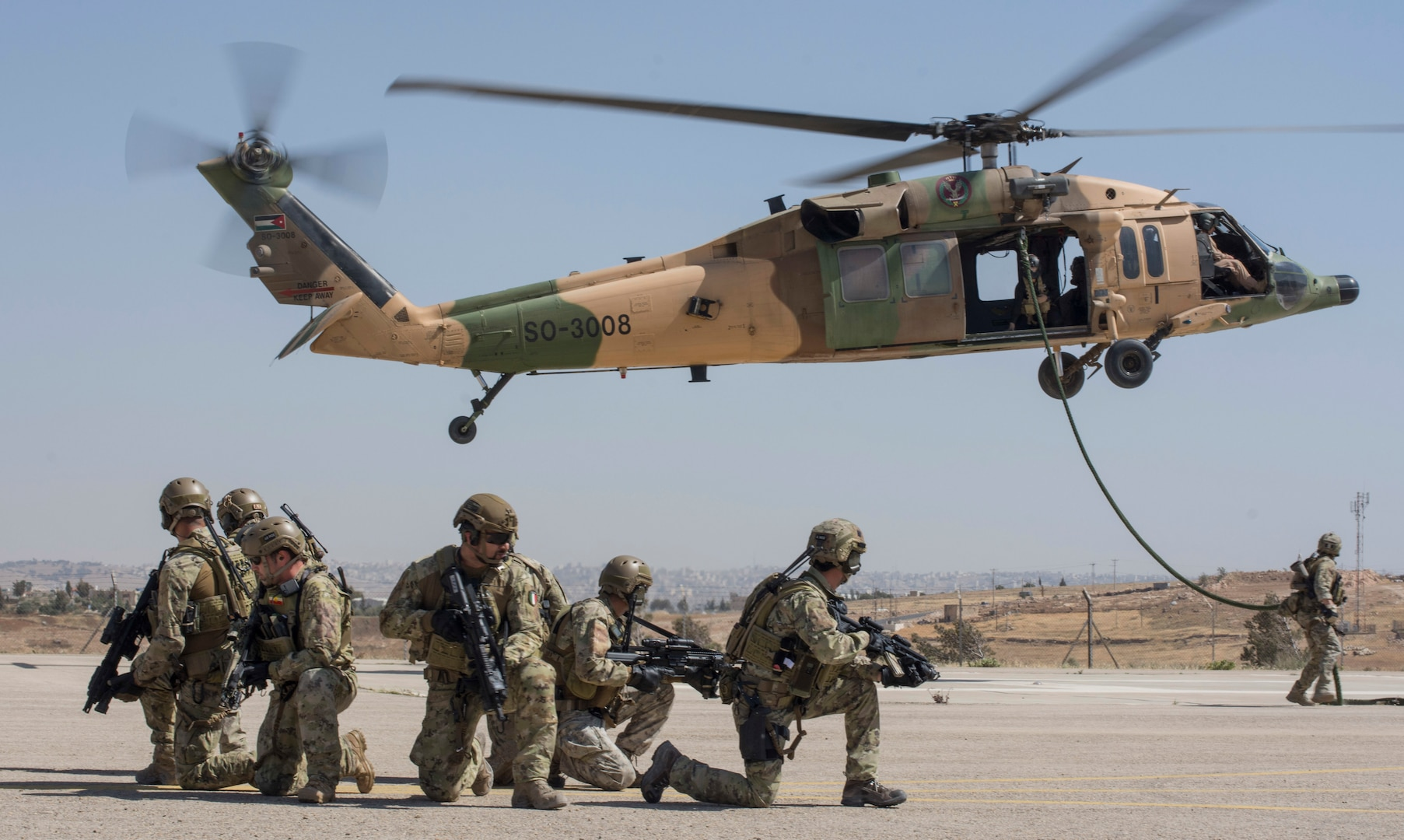 AMMAN, Jordan (May 7, 2017) Italian Airmen assigned to the 17th Special Operations Wing secure a landing pad during a fast roping exercise in Amman, Jordan during Eager Lion 2017. Eager Lion is an annual U.S. Central Command exercise in Jordan designed to strengthen military-to-military relationships between the U.S., Jordan and other international partners. This year's iteration is comprised of about 7,200 military personnel from more than 20 nations that will respond to scenarios involving border security, command and control, cyber defense and battlespace management. (U.S. Navy photo by Mass Communication Specialist 2nd Class Christopher Lange/Released)
