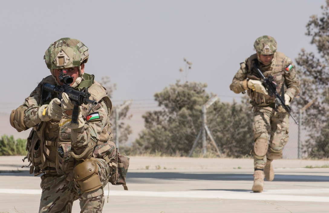 AMMAN, Jordan (May 7, 2017) Members of the Jordanian Special Operations secure a landing pad during a fast roping exercise in Amman, Jordan during Eager Lion 2017. Eager Lion is an annual U.S. Central Command exercise in Jordan designed to strengthen military-to-military relationships between the U.S., Jordan and other international partners. This year's iteration is comprised of about 7,200 military personnel from more than 20 nations that will respond to scenarios involving border security, command and control, cyber defense and battlespace management. (U.S. Navy photo by Mass Communication Specialist 2nd Class Christopher Lange/Released)