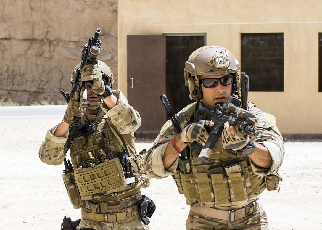 AMMAN, Jordan (May 8, 2017) A member of the Air Force Special Operation's 23rd Special Tactics Squad and Italian Special Forces participate in small unit tactics at the King Abdullah II Special Operations Training Center in Amman, Jordan during Eager Lion 2017. Eager Lion is an annual U.S. Central Command exercise in Jordan designed to strengthen military-to-military relationships between the U.S., Jordan and other international partners. This year's iteration is comprised of about 7,200 military personnel from more than 20 nations that will respond to scenarios involving border security, command and control, cyber defense and battlespace management. (U.S. Navy photo by Mass Communication Specialist 2nd Class Christopher Lange/Released)