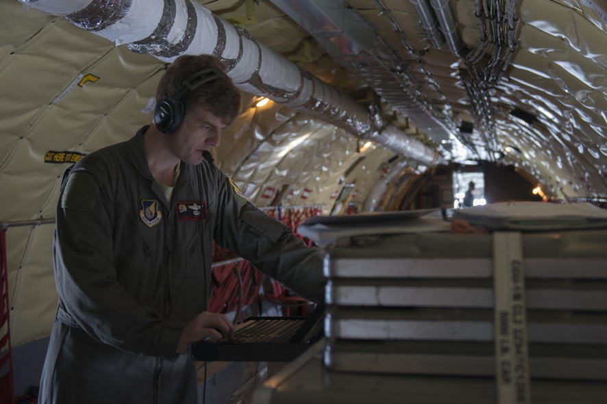 EIELSON AIR FORCE BASE, Alaska – U.S. Air Force Maj. Scott Karl, a 909th Air Refueling Squadron KC-135 instructor pilot assigned to Kadena Air Base, Japan, checks the status of a Roll-On Beyond-Line-of-Sight Enhancement system on a KC-135T Stratotanker from Fairchild Air Force Base, Wash., May 9, 2017, during NORTHERN EDGE 2017 (NE17), over the Joint Pacific-Alaska Range Complex. NE17 is Alaska's premier joint training exercise designed to practice operations, techniques and procedures as well as enhance interoperability among the services. Thousands of participants from all the services, Airmen, Soldiers, Sailors, Marines and Coast Guardsmen from active duty, Reserve and National Guard units are involved. (U.S. Air Force photo/Staff Sgt. Ashley Nicole Taylor)