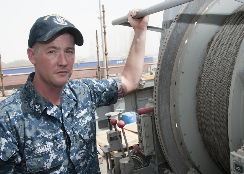 MANAMA, Bahrain (May 9, 2017) Mineman 2nd Class Tyler Smith, a native of Munford, Ala. and assigned to the Avenger-class mine countermeasure ship USS Devastator (MCM 6), poses for a photo in front of Devastator's sweep line. On April 23, Smith deployed to the Avenger-class mine countermeasure ship USS Dextrous (MCM 13) and repaired the ship's swage, a thick metal clasp that secures the ship's sweep wire and withstands up to 18,000 pounds of pressure. (U.S. Navy photo by Mass Communication Specialist 2nd Class Victoria Kinney)
