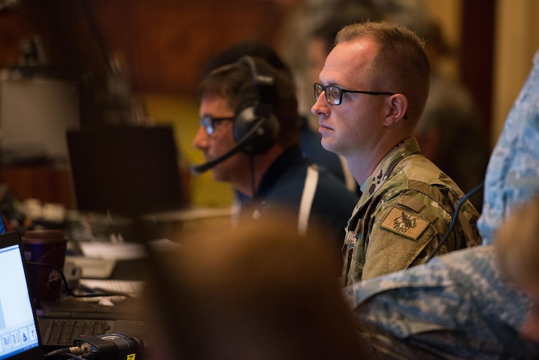 Senior Airman Zachary Hart, 137th Special Operations Wing information technology network specialist, prepares a video teleconference during the 2017 Air National Guard Leadership Conference at the National Center for Employee Development Conference Center, Norman, Okla., May 8, 2017. The leadership conference, attended by general officers, adjutant generals, wing commanders, command chiefs and directors of staff from across the 54 U.S. states and territories, focused on leading, protecting and supporting the 21st-century Guard Airman. (U.S. Air National Guard photo by Senior Master Sgt. Andrew M. LaMoreaux)
