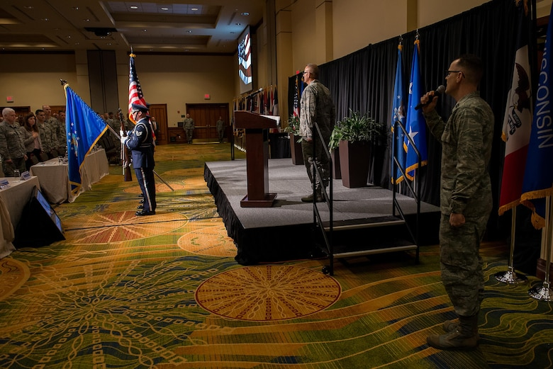 The 137th Special Operations Wing Honor Guard presents the colors while Capt. Paul Blankenship, 137 SOW Force Support Squadron food service officer, sings a stirring rendition of the national anthem to open the 2017 Air National Guard Leadership Conference at the National Center for Employee Development Conference Center, Norman, Okla., May 8, 2017. The leadership conference, attended by general officers, adjutant generals, wing commanders, command chiefs and directors of staff from across the 54 U.S. states and territories, focused on leading, protecting and supporting the 21st-century Guard Airman. (U.S. Air National Guard photo by Senior Master Sgt. Andrew M. LaMoreaux)