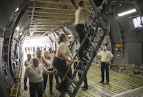 Members of the Department of Defense Executive Leadership Development Program tour the troop compartment of a C-5M Super Galaxy aircraft May 10, 2017 at Joint Base San Antonio-Lackland, Texas. (U.S. Air Force photo by Benjamin Faske)