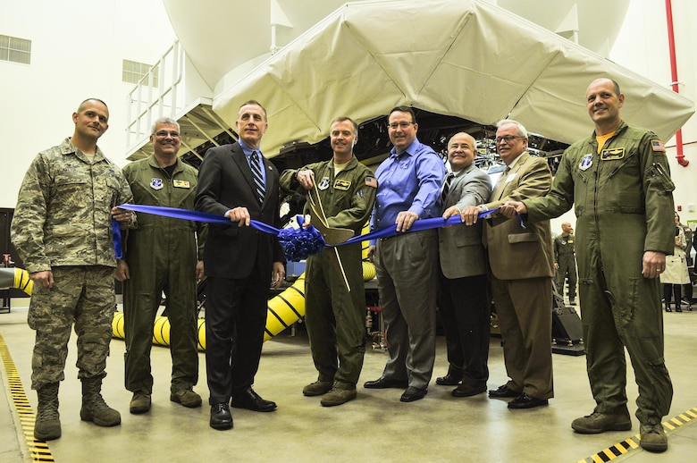 A ribbon is cut to signify the opening of a KC-135 flight simulator at the 171st Air Refueling Wing near Pittsburgh Pa. May 5, 2017. Holding the ribbon from left to right is Maj. Jeremy Ketter, Commander of the 171 Civil Engineer Squadron, Brig. Gen. Tony Carrelli, Pennsylvania Adjutant General, Congressman Tim Murphy, representing the 18th district of Pennsylvania, Col. Gregg Perez, 171st Wing Commander, Tim Bush, KC-135 Aviation Training System Operations and Maintenance Program Manager for CAE, Cliff Sanchez, KC-135 Aviation Training System Manager at Air Mobility Command, Rep. Mark Mustio, 44th Legislative District, western Allegheny, and Lt. Colonel, Jim Swanik, Operations Support Commander. (U.S. Air National Guard photo by Staff Sgt. Manners)