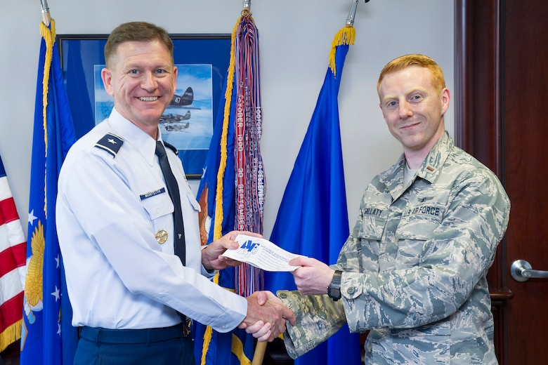 Brig. Gen. Wayne Monteith, 45th Space Wing commander, gives his Air Force Assistance Fund donation form to 2nd Lt. Walter Gallaty, 1st Range Operations Squadron officer and AFAF project officer, May 10, 2017, at Patrick Air Force Base, Fla. The Air Force Assistance Fund campaign began April 10, 2017, and runs through May 19, 2017. The Air Force Assistance Fund is an annual effort to raise funds for the charitable affiliates that provide support to Air Force families in need; such as: active duty, retirees, reservists, guard and dependents, including surviving spouses. (U.S. Air Force photo by Phil Sunkel)