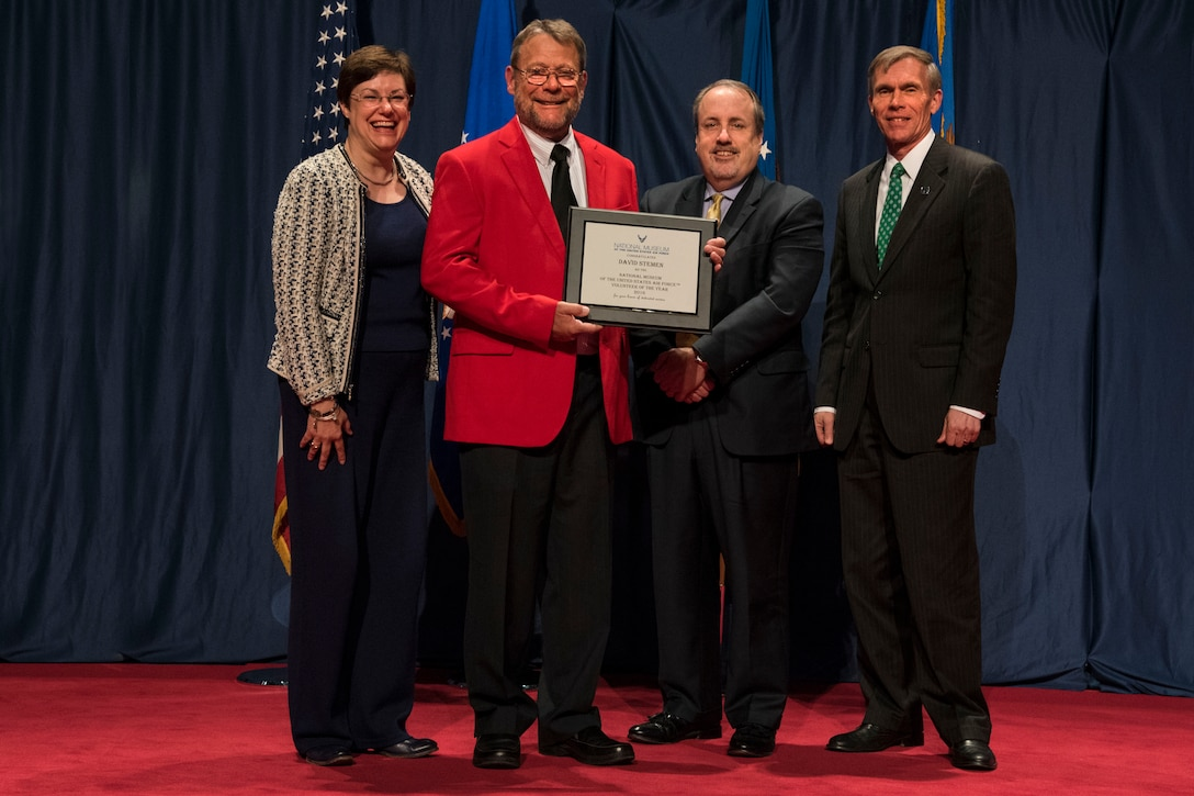 DAYTON, Ohio -- David Stemen (red jacket) received the 2016 Director's Award for Volunteer of the Year for his dedication and excellence in serving the National Museum of the U.S. Air Force. (from left to right) Air Force Materiel Command Executive Director Patricia M. Young, Volunteer David Stemen, Air Force Museum Foundation Executive Director Michael P. Imhoff and Museum Director Lt. Gen.(Ret.) Jack Hudson. (U.S. Air Force photo)