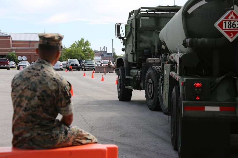 Cpl. Austin Pastor observes a student operating a M970 semitrailer refueler truck during a Semitrailer Refueler Operator Course held at Marine Corps Air Station Cherry Point, N.C., May 9, 2017. Upon completion of the month-long course, motor transport Marines gain the secondary military occupational specialty of semitrailer refueler operator. Pastor is a mobile refueler assigned to Marine Wing Support Squadron 272, Marine Aircraft Group 26, 2nd Marine Aircraft Wing. (U.S. Marine Corps photo by Cpl. Jason Jimenez/ Released)