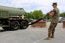 Pfc. Jacob Hankins pulls a hose from the fueling compartment of a M970 semitrailer refueler truck during a Semitrailer Refueler Operator Course at Marine Corps Air Station Cherry Point, N.C., May 9, 2017. Marines are evaluated upon completing four tests; three written and one road test. Upon completion of the course, motor transport Marines gain the secondary military occupational specialty, semitrailer refueler operator. Hankins is a motor transport operator with 2nd Transport Battalion, Combat Logistics Regiment 2, 2nd Marine Logistics Group. (U.S. Marine Corps photo by Cpl. Jason Jimenez/ Released)
