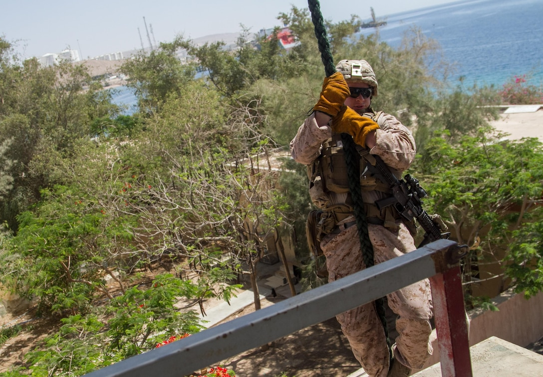 A U.S. Marine demonstrates fast roping during a joint exercise in Aqaba, Jordan, during Eager Lion 2017.  Eager Lion is an annual U.S. Central Command exercise in Jordan designed to strengthen military-to-military relationships between the U.S., Jordan and other international partners. This year's iteration is comprised of about 7,200 military personnel from more than 20 nations that will respond to scenarios involving border security, command and control, cyber defense and battlespace management.  (U.S. Army photo by Sgt. Mickey A. Miller)