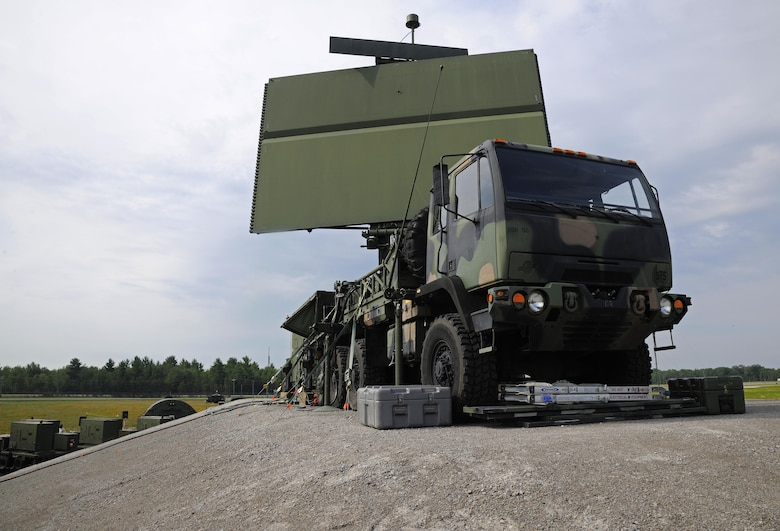 A AN/TPS-75 radar rests on the back of a transport vehicle at the Alpena Combat Readiness Training Center, Mich., July 29, 2015. The AN/TPS-75 radar is capable of providing coverage of more than 200 nautical miles in every direction and detecting aircraft as high as 95,000 ft. Following release of a contract award May 11, 2017, the radar, dating to the Vietnam War era and containing vacuum tube technology, will be replaced by Raytheon Co. built three dimensional expeditionary long-range radars by 2028.  (U.S. Air National Guard photo by Senior Airman Ryan Zeski/Released)