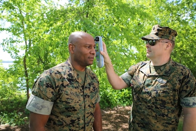 Navy Chief Petty Officer Jared Anderson, a hospital corpsman, uses an Infrascanner to assess Marine Corps Master Gunnery Sgt. Maceo Mathis for intracranial hematomas -- bleeding within the skull -- at Marine Corps Base Quantico, Va., May 8, 2017. The scanner is a portable, medical diagnostic device that provides early detection of intracranial hematomas in the field, potentially saving lives and improving casualty care and recovery. Infrascanners are available for medical personnel for use at battalion aid stations across the Marine Corps. Marine Corps photo by Ashley Calingo