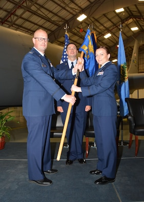 Maj. Melissa Jones, 507th Maintenance Squadron commander, takes the guidon from Col. Travis Caughlin, 507th Maintenance Group commander May 6, 2017, during the 507th Maintenance Squadron change of command ceremony at Tinker Air Force Base, Okla. (U.S. Air Force photo/Tech. Sgt. Lauren Gleason)