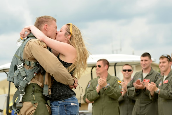 A U.S. Airman assigned to the 79th Fighter Squadron kisses his spouse after returning to Shaw Air Force Base, S.C., May 4, 2017. Airmen returned after a six-month deployment to the U.S. Central Command area of responsibility. (U.S. Air Force photo by Airman 1st Class Kathryn R.C. Reaves)