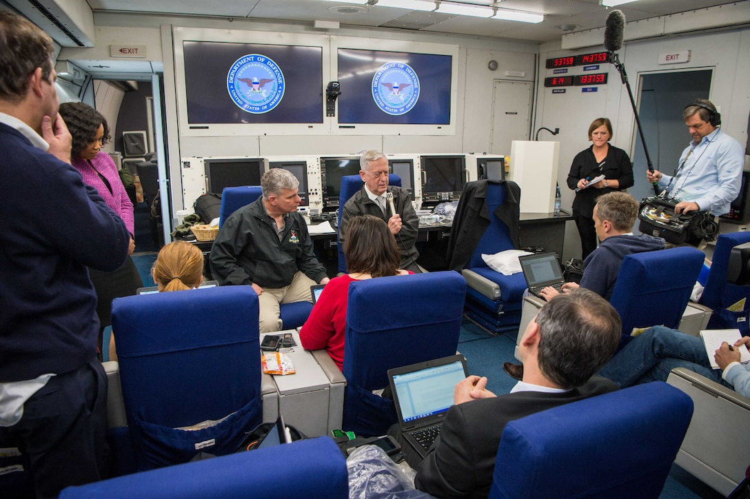 Defense Secretary Jim Mattis briefs the press during a flight to Washington, D.C.