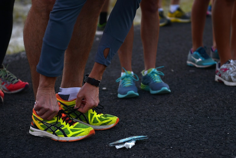 A contestant ties his shoes in preparation for the 2017 Adventure Race in Del Rio, Texas, May 6, 2017. The first three-mile leg of the event was a run from Laughlin Air Force Base's West Gate, to the first hand-off station, where the teams transitioned for the 20-mile bike ride. (U.S. Air Force photo/ Airman 1st Class Benjamin N. Valmoja)