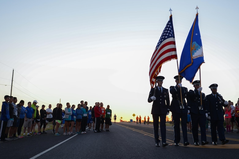Laughlin's Honor Guard marches away after presenting the colors in Del Rio, Texas, May 6, 2017. The honor guard presented the colors before the start of the 2017 Adventure Race, which included a three-mile run from the west gate of Laughlin Air Force Base, a 20-mile bike ride to Lake Amistad and a one-mile row. (U.S. Air Force photo/Airman 1st Class Benjamin N. Valmoja)