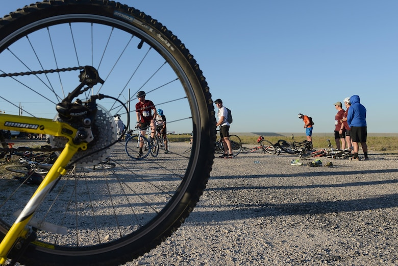 A contestant mounts his bike during the 2017 Adventure Race, in Del Rio, Texas, May 6, 2017. All competetors had to complete the biking section of the event – a 20-mile ride to Lake Amistad. (U.S. Air Force photo/Airman 1st Class Benjamin N. Valmoja)