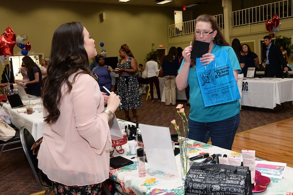 An attendee of the Joint Base San Antonio-Lackland Military & Family Readiness Center Military Spouse Appreciation Event samples products May 4 , 2017, at JBSA-Lackland, Texas. The staff of the M&FRC at JBSA –Lackland hosted the event to honor military spouses and provide a platform for spouses who are entrepreneurs to showcase their businesses. (U.S. Air Force photo by Staff Sgt. Marissa Garner)