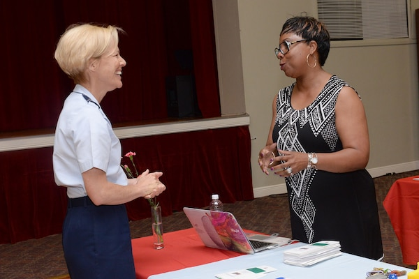 Brig. Gen. Heather Pringle, 502nd Air Base Wing and Joint Base San Antonio commander, speaks with Donna Hollie, Defense Language Institute English Language Center filed studies specialist, during the JBSA-Lackland Military Spouse Appreciation Event May 4, 2017, at Arnold Hall Community Center.  The JBSA-Lackland Military & Family Readiness Center hosted the event to celebrate military spouses and provide an opportunity for them to showcase their personal businesses to the community. (U.S. Air Force photo by Staff Sgt. Marissa Garner)