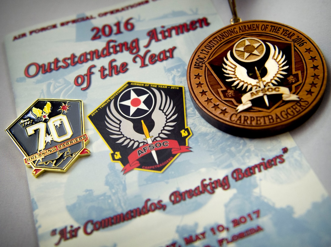 A program, pin and medallion are displayed at Air Force Special Operations Command's 2016 Outstanding Airmen of the Year banquet at Hurlburt Field, Fla., May 10, 2017. AFSOC formally recognized its outstanding Airmen of the year with a weeklong tour of Hurlburt Field. (U.S. Air Force photo by Senior Airman Krystal M. Garrett)