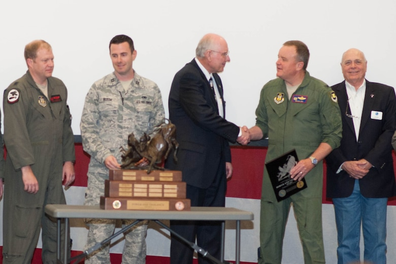 """Colonel Bruce Cox accepts the Tenth Air Force Power and Vigilance Award from Mr. John Johnson of the Air Power Foundation. The Power and Vigilance Ward goes to the Tenth Air Force Unit that exhibits the Numbered Air Force's mission as """"The premier provider of affordable, integrated, flexible, and mission-ready Citizen Airmen to execute power and vigilance in support of U.S. National Security."""""""