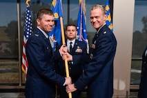 Col. Toby Doran, 50th Operations Group commander accepts the 3rd Space Experimentation Squadron guidon from Lt. Col. Zachary Owen during the squadron's change of command ceremony at Schriever Air Force Base, Colorado, April 6, 2017. Lt. Col. Kevin Amsden assumed command of the squadron. (U.S. Air Force photo/Chris DeWitt)