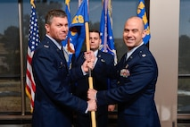 Col. Toby Doran, 50th Operations Group commander, presents the 3rd Space Experimentation Squadron guidon to Lt. Col. Kevin Amsden during the squadron's change of command ceremony at Schriever Air Force Base, Colorado, April 6, 2017. Benson assumed command of the squadron from Lt. Col. Zachary Owen. (U.S. Air Force photo/Chris DeWitt)