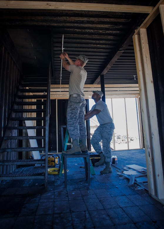 U.S. Air Force Airmen assigned to the 153rd Civil Engineer Squadron assist  Laramie County Fire District #2 with preparing their fire training structure for the upcoming Honoring Tradition, Leading Change Conference, May 6, 2017 in Cheyenne, Wyoming. The engineers were asked to install walls to create various rooms and add a fire suppression system within the district's training structure. The project provided the water and fuels systems maintenance flight and the structural flight Airmen a chance to maintain their proficiency while helping the community. (U.S. Air National Guard photo by Tech. Sgt. John Galvin/Released)