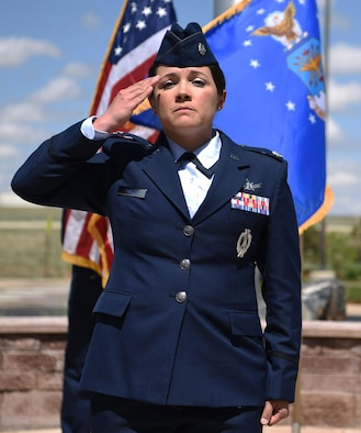 Lt. Col. Shannon DaSilva, 2nd Space Warning Squadron commander, renders the first salute to her new squadron May 11, 2017, on Buckley Air Force Base, Colo. Shannon is now responsible for the primary operations unit within the 460th OG, which continues to operate a more than 40-year-old, $3.2 billion on-orbit Defense Support Program satellite constellation. (U.S. Air Force photo by Airman 1st Class Holden S. Faul/Released)