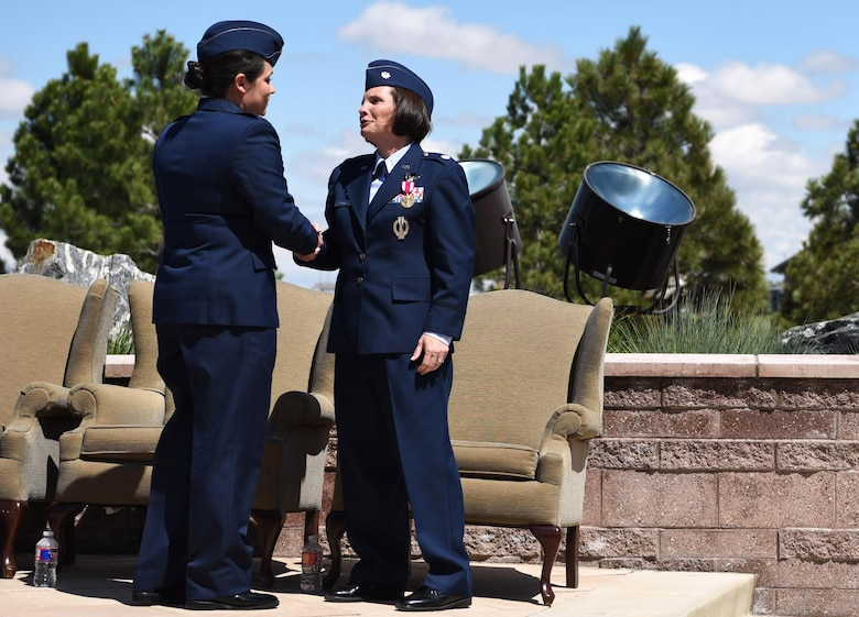 From left to right: Lt. Col. Shannon DaSilva, 2nd Space Warning Squadron commander, shares words with Lt. Col. April Wimmer, 2nd SWS parting commander, after their change of command ceremony May 11, 2017. At Buckley Air Force Base, Colo. Shannon is now responsible for the primary operations unit within the 460th OG, which continues to operate a more than 40-year-old, $3.2 billion on-orbit Defense Support Program satellite constellation. (U.S. Air Force photo by Airman 1st Class Holden S. Faul/Released)